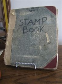 Stamp book started in 1933 fairly full