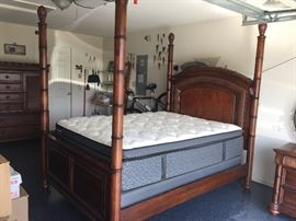 Queen Cindy Crawford 4 post bed, set includes headboard, footboard, Chest of Drawers and Nightstand for $650