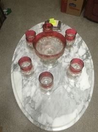 Marble top coffee table w/ flashed vintage glasses. Also have marble top end tables and server