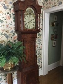 Reproduction clock with hand-painted face