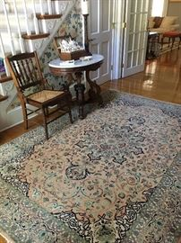 Wool and silk area rug.