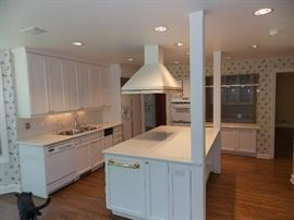 Johnson and King Kitchen cabinets, Kenmore Dishwasher,  Kenmore Cooktop, GE side by side Refrigerator , GE double wall oven, reclaimed hardwood flooring, handcrafted hood from Denmark.