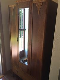 Antique mirrored clothing armoire $800