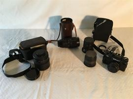 Assorted Camera Lens & 122 Zenit Camera in Case              https://ctbids.com/#!/description/share/26610