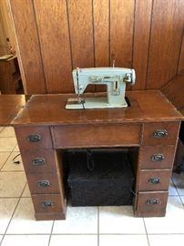 Sewing machine in desk