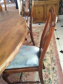 Eight matching chairs fit nicely around the dining table.