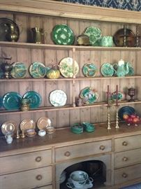 Fabulous collection of green majolica and other selections on this stunning antique breakfront