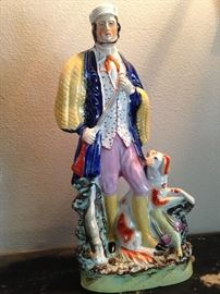 Staffordshire figurine of a man and his dog (Staffordshire figurines were made in the English county of the same name for over 200 years.)