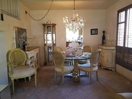 Beautiful dining table and painted wine cabinet and buffet.
