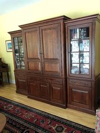 Hand-crafted mahogany entertainment center with pull out shelving and endless storage