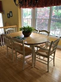 Deliciously beautiful wooded top kitchen set with (6) rattan seated chairs with spindle back accents