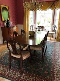 Dining room with (2) pads,(1) leaf, (2) armed chairs, (6) dining chairs