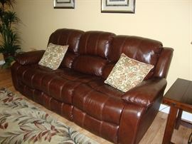 Leather type Sofa with reclining end Seats, Wall Hugger