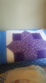 Quilt..it has been quilted. Needs band on the outside