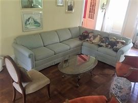 The Upholstered Sofa Is In Very Good Condition - along with the Glass and Iron Coffee Table