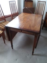 Drop-leaf dining table has 6 chairs and 2 leafs (includes custom fit surface protectors)