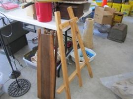 Antique ironing board.  Easel and hanging bird house/flower stands