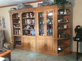 "This is a 5 cabnet wall unit. 11 feet long 6'8"" tall. It has lead glass doors and detailed trim. Asking $600."