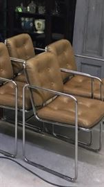 Set of 4 mid-century chrome dining arm chairs.