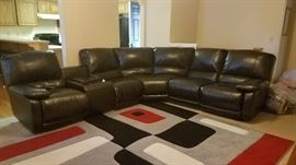 LIKE NEW SECRIONAL RECLINING SOFA WITH STORAGE.  NEW FROM FURNITURE ON CONSIGNMENT @ 2500.00. A FEW YEARS AGO