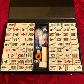 Portable Mahjong in a case http://www.ctonlineauctions.com/detail.asp?id=729004