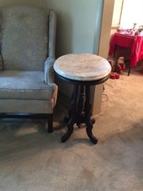 Antique Victorian marble coffee table. Beveled marble top and mahogany wood base.