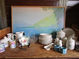 Collection of ceramic and pottery dishware with an amazing original piece of art done in chalk