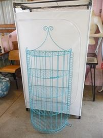 covered clothes rack / blue shelving