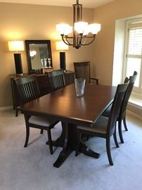 Custom made by Amish craftsman, dining room table includes chairs and table pads. EX CONDITION! Who do you know that could use this heirloom quality piece?