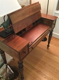 Image of the desk with the top open.