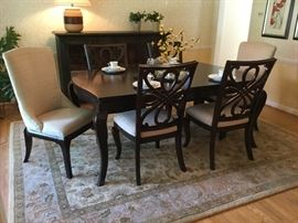 Beautiful dining set; table w/ one large leaf, two upholstered chairs, 4 dining chairs.