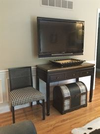 Sony flat screen, hand painted antique desk, hound's-tooth upcycled chair.