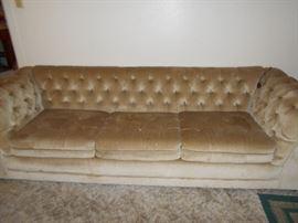 Tufted beige sofa