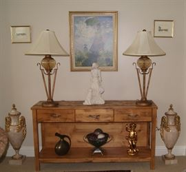 Lamps, sofa table and decor.