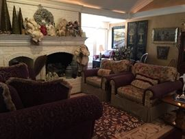 The Sitting Room has a beautiful purple sculptured sofa and two upholstered arm chairs. Lots of great Christmas decorations