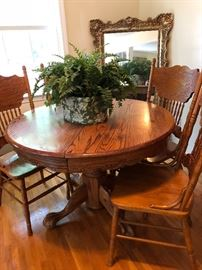 Round/oval drop leaf Dining table and four matching chairs.