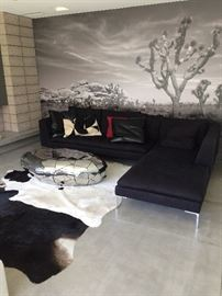 "Custom Denim Sectional, Cow Hide Rugs and ""Crazy Cut"" Mirrored Coffee Table"