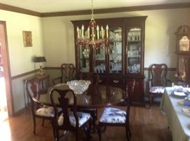Cherry dining room set with table and 6 chairs.   Grandfather clock.   China cabinet