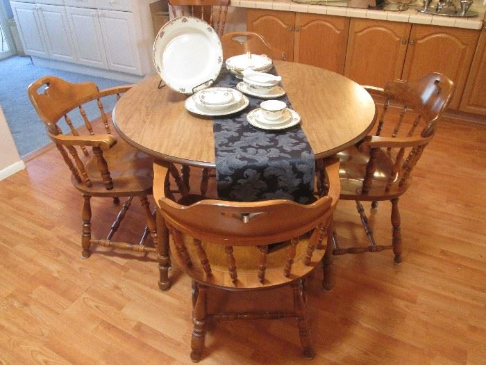 Colonial-style Dining/Dinette Table with 1-Leaf.  Arm Chairs (4) sold separately
