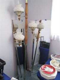 Pole Lamp and Several Floor-Length Mirrors