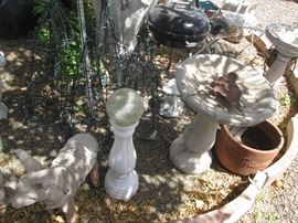 More Bird Baths and I think I see a Weber Grill in the background