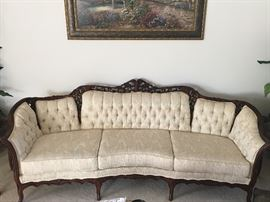 Fantastic Kimball  French Provincial sofa in perfect condition with fabulous carvings and button tufted upholstery.