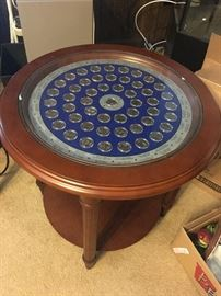 End table with silver dollar display in protective case