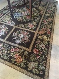 Needle point beautiful rug with a small rip
