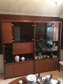 Stunning wall unit display system-brought from Overton erseas military travels vintage Asian Contempoary flair, this one has a dry bar in it.