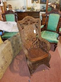ANTIQUE WICKER ROCKER (SIGNED)
