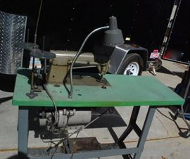 Industrial sewing machine.  This was maintained like the proud owner of a Cadillac.  We drained the coolant to move it from San Gabriel.  Tested prior to move.