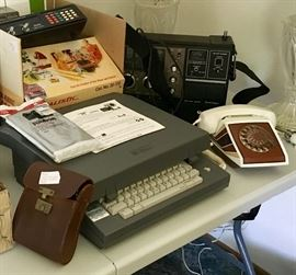Lots of unique vintage items including digital typewriter and ribbon, rare vintage rotary phone, multiple pairs of vintage binoculars, several CB and multi-band radios / receivers (some not pictured)