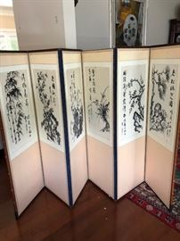 The home features many Chinese and Korean themed items, including this wall divider, painted with watercolor charcoal.