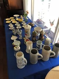 Large collections of steins, bone china and crystal.